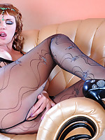 Exotic dancer plays with laddered fashion hose and puts on new pink nylons