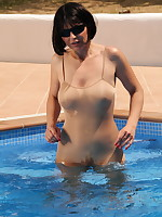 Pantyhose Diva gets wet in her swimming pool