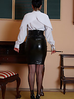 I am the teacher you have been dreaming of. If you stare long enough i might unbutton my silk blouse to show you my big tits in my vintage bullet bra, my crotchless knickers, black stockings and satin suspender belt